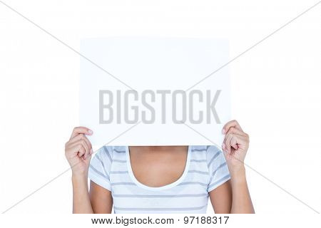 Woman putting paper over her faces on white background