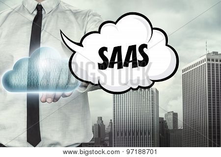 Saas text on cloud computing theme with businessman