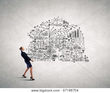 Young businesswoman carrying her great business plan in hands