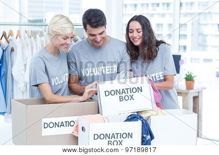 Happy volunteers friends checking a donation list