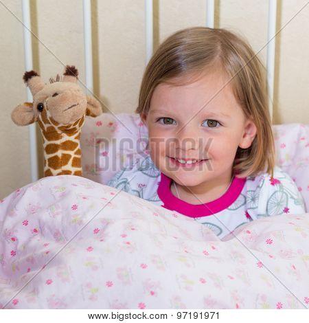 Beautiful Little Girl In The Crib.