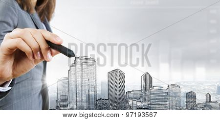 Chest view of businesswoman drawing sketches of construction project on screen