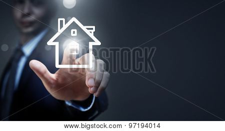 Close up of businessman hand holding house model