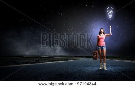 Traveler woman with retro suitcase waiting for car