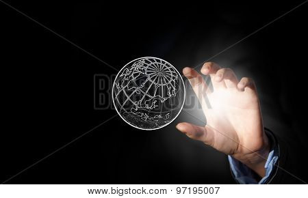 Close up of businessman handtaking planet sign