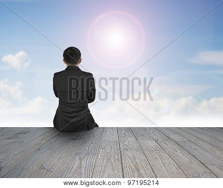 Rear View Man Sitting On Wooden Floor With Sunlight Cloudscape