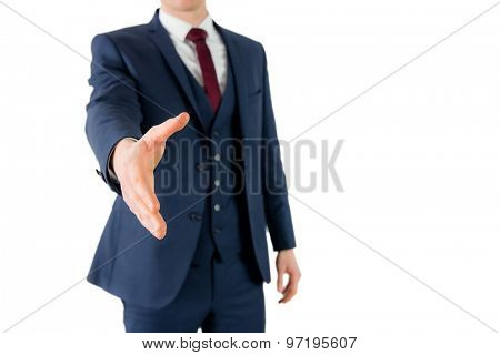 Businessman ready to shake hand on white background