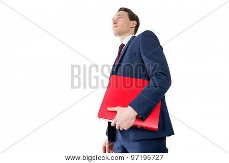 Thoughtful businessman holding red folder on white background