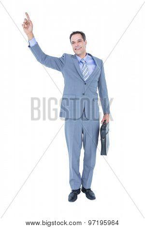 Cheerful businessman raising his fist on white screen