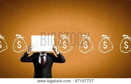 Unrecognizable businessman holding paper covering her face