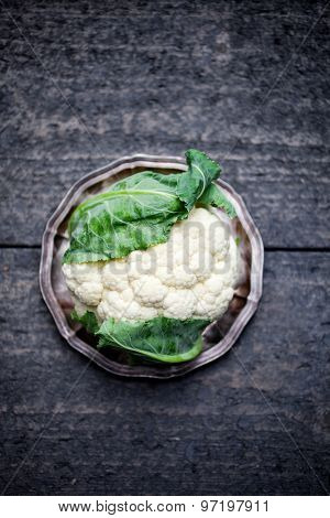 Fresh cauliflower on dark table
