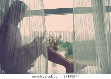 Sitting On Window-sill