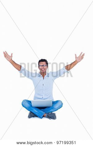 Happy handsome man cheering with arms up on white background