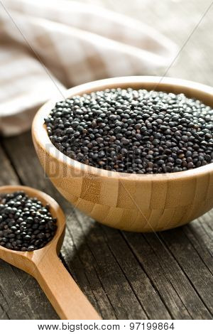 Beluga. Black lentil in wooden bowl.