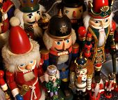 picture of tchaikovsky  - a gathering of nutcrackers with brightly painted kings princes soldiers and santa claus - JPG