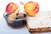 stock photo of sukkoth  - Honey in a glass vase with a special spoon matzah and nectarine - JPG