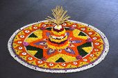 stock photo of pookolam  - Kerala festival of onam colorful flowers decoration - JPG