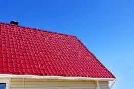 picture of red roof  - New red roof tiles against of blue sky - JPG