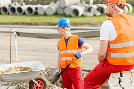 pic of labourer  - Physical labourers working outdoor and repairing road - JPG