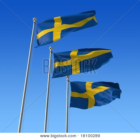 Flags of Sweden against blue sky.