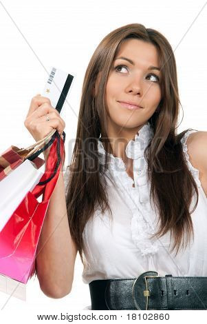 Woman Holding Credit Card And Shopping Bags In Hands