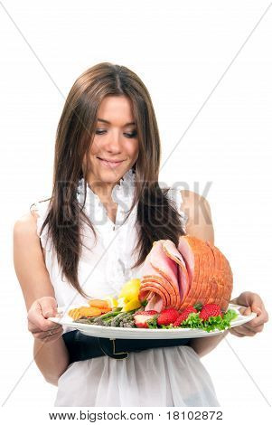 Woman Holding A Plate With Turkey Ham