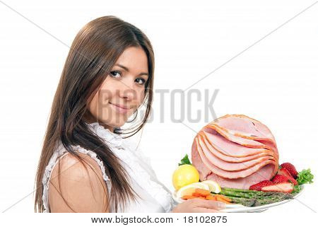 Woman Holding A Plate With Sliced Ham