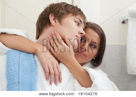 Young Happy Couple In A Bathroom.