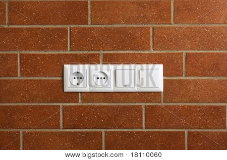 Power Outlets On The Brick Wall