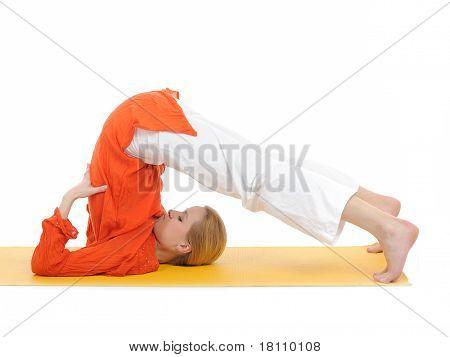 Series Or Yoga Photos. Young Woman In Halasana Pose On Yellow Pilates Mat
