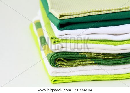 Pile of linen kitchen towels with space for your text