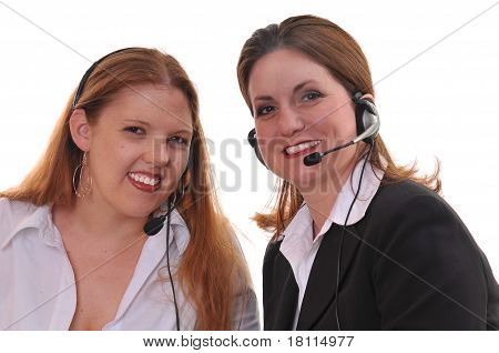 Two business women with headsets