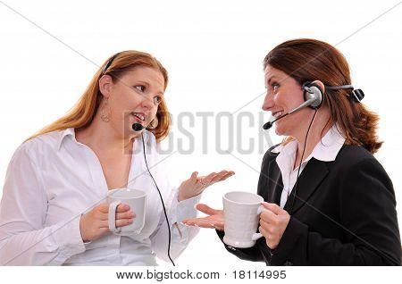 Business women drinking coffee
