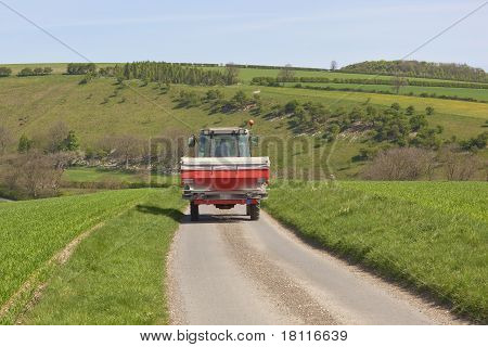 Tractor With Fertilizer Spreader