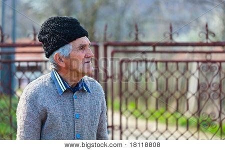 Old Man Near A Gate
