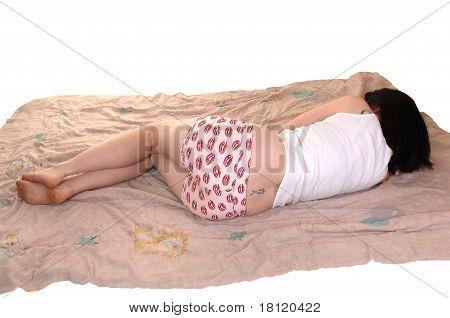 Girl Lying On Comforter.