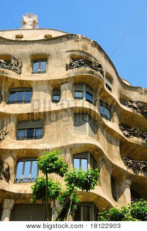 BARCELONA, SPAIN - MAY 23: Casa Mila, or La Pedrera, on May 23, 2010 in Barcelona, Spain. This famous building, designed by Antoni Gaudi, was built between 1906 and 1910