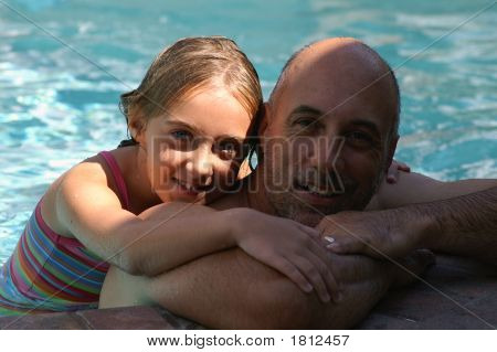 Father & Daughter In Pool