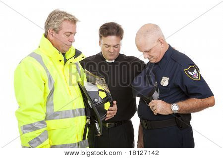 Minister prays with a firefighter and police officer at work.  Isolated on white.