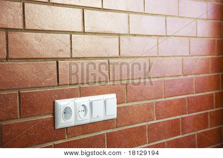 Power Outlets On The Brick Wall / Horizontal / Photo
