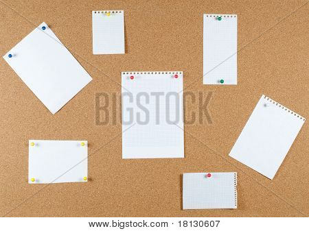 collection of note papers on corkboard