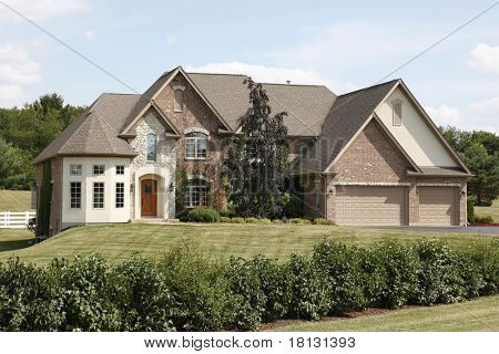 Luxury home with arched entry and three car garage