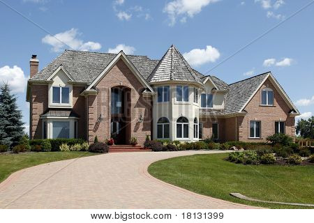 Large home in suburbs with turret and arched entry