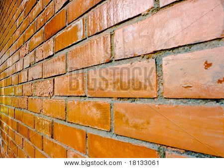 Close-up Details Of A Orange-brown Brick Wall.