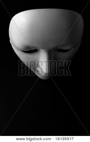White opera mask on black background