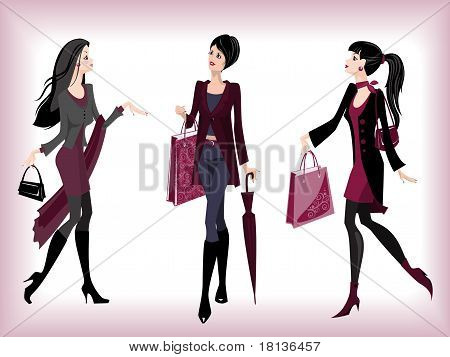 Fashionable women going from shop