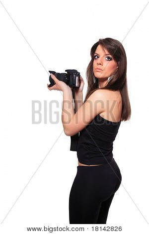 Female photographer with DSLR Camera taking pictures over white background