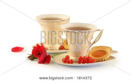 Two Cups Of Tea On A White Background.