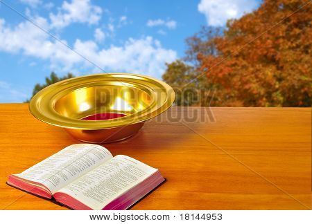 Offering Plate On Table With Bible And Bright Background