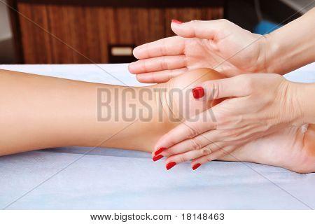 Shot of spa salon, reflexology foot massage.